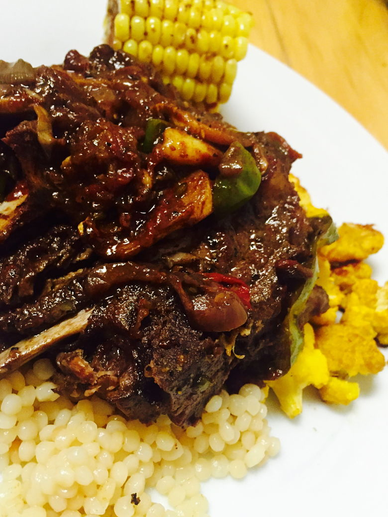 Braised lamb chops with yellow cauliflower and pearled couscous