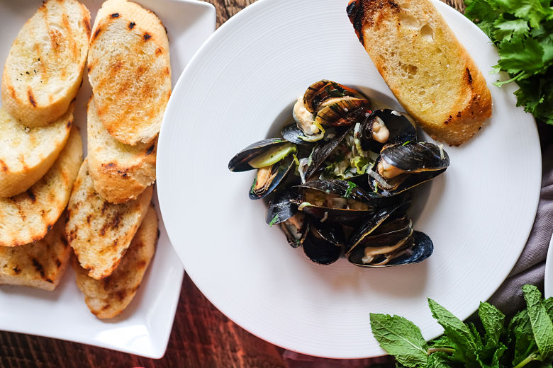 Plump, steamed mussels simmered in a creamy, spicy, citrusy coconut sauce.